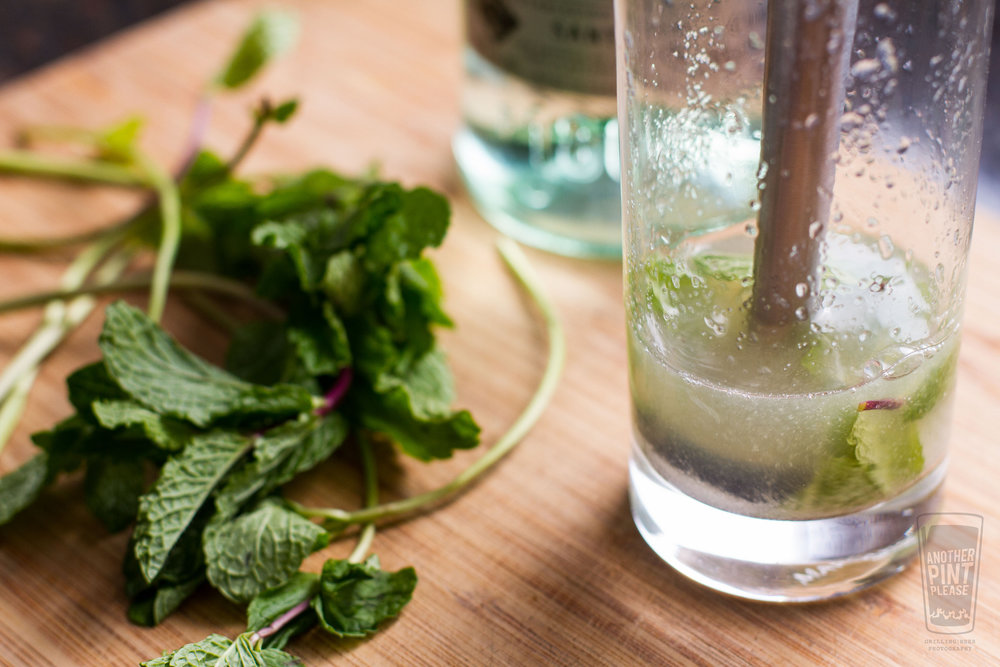 muddling mint leaves for mojito.jpg