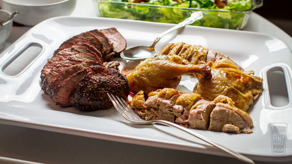 beef tenderloin and grilled duck on platter.jpg