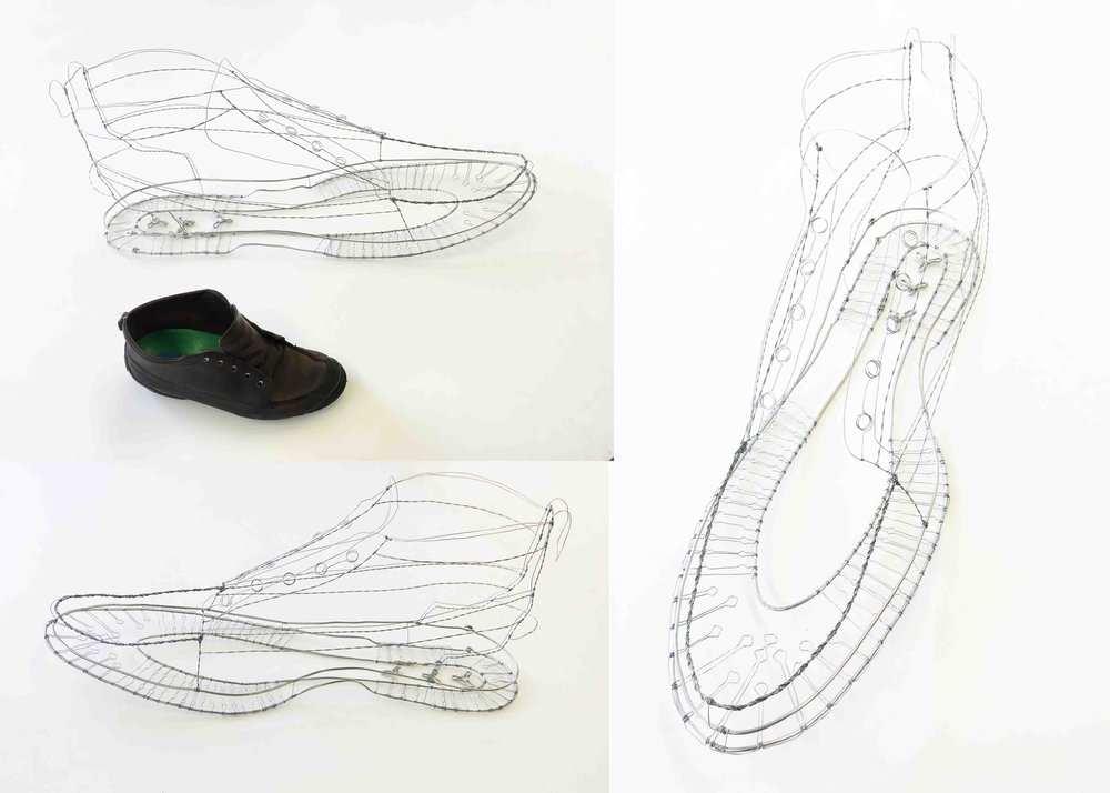 Wire sculpture of shoe.