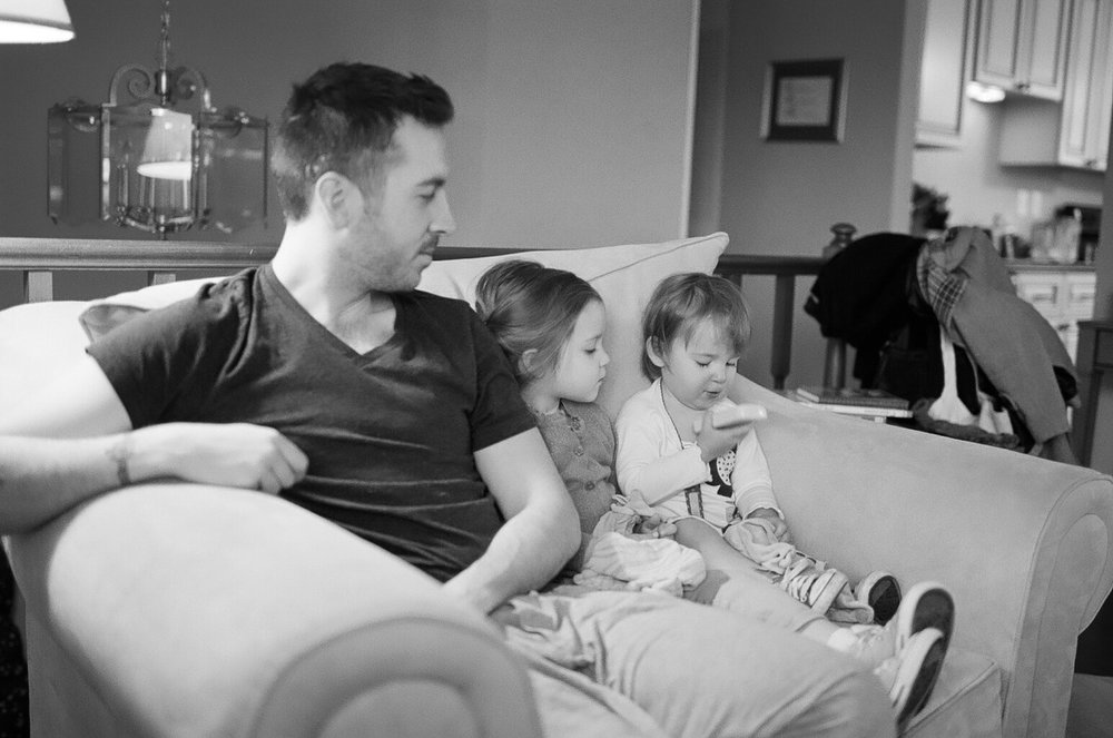 Saturday morning family chair time.   F100, Portra 400 converted to B&W.  Walgreens Scan.