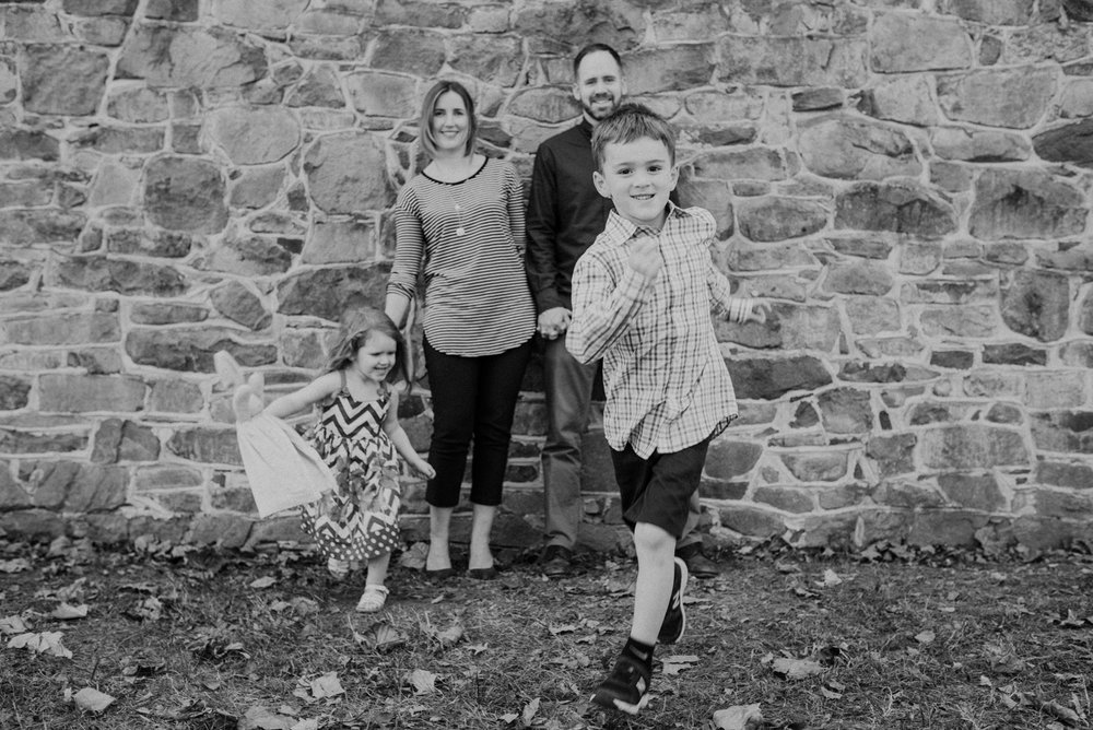 black and white family action portrait