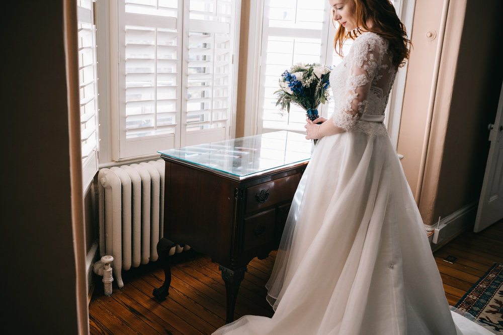 bridal portrait and bouquet in window light