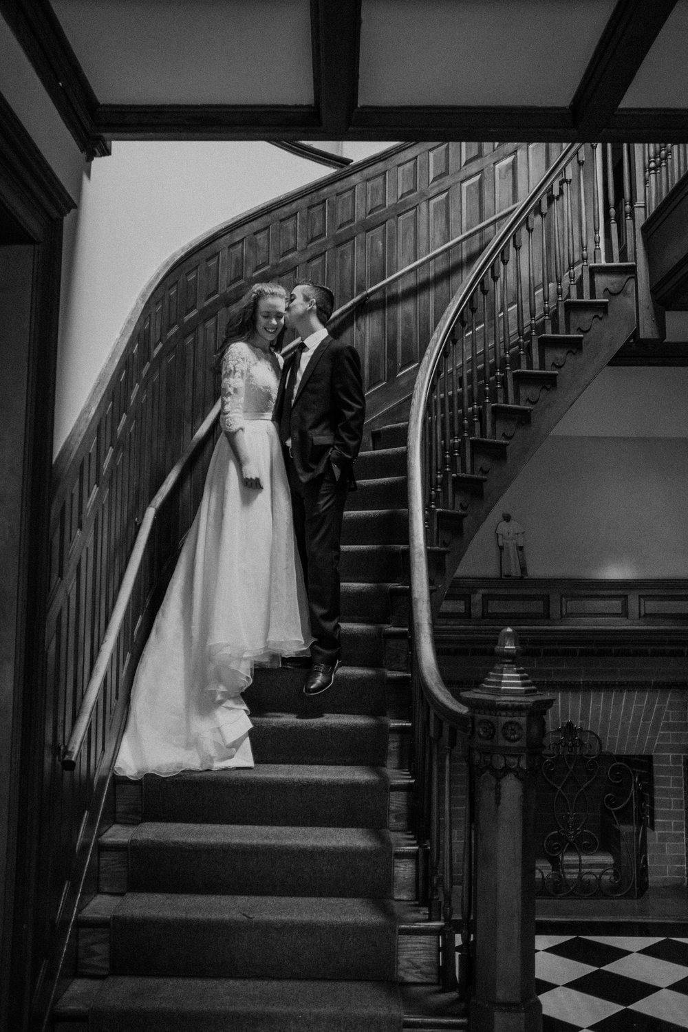 classic bride and groom wedding portrait on staircase