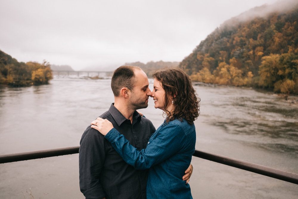 autumn engagement photo potomac river harpers ferry