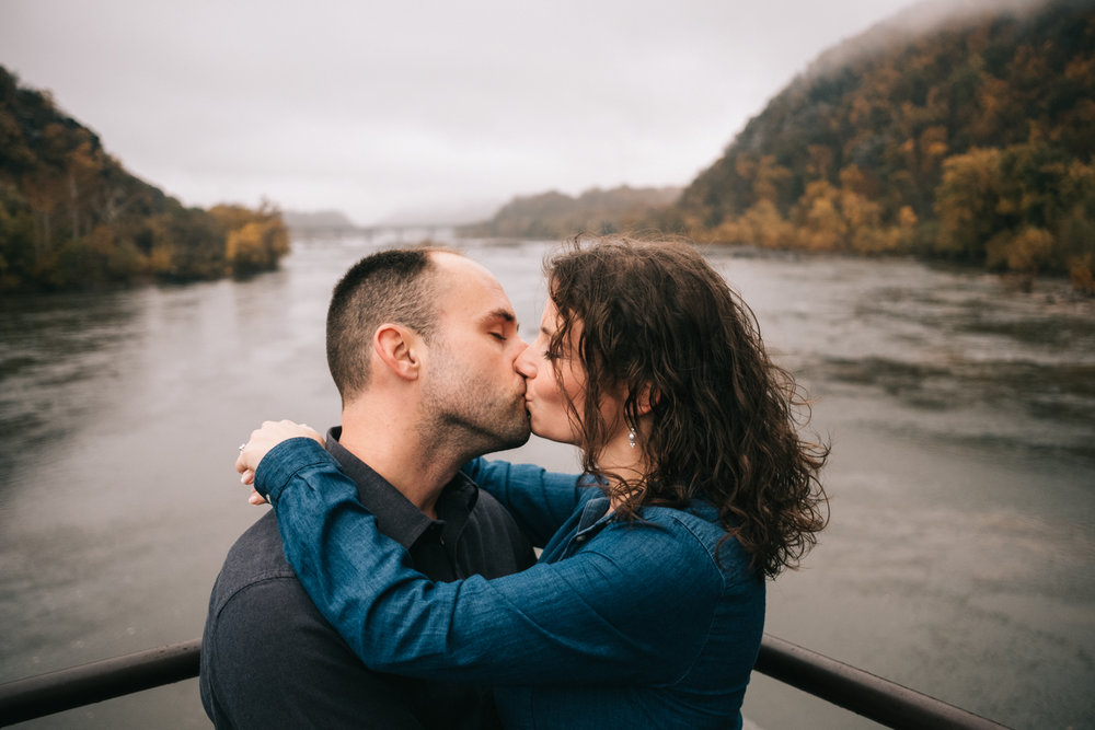 engaged couple kissing harpers ferry