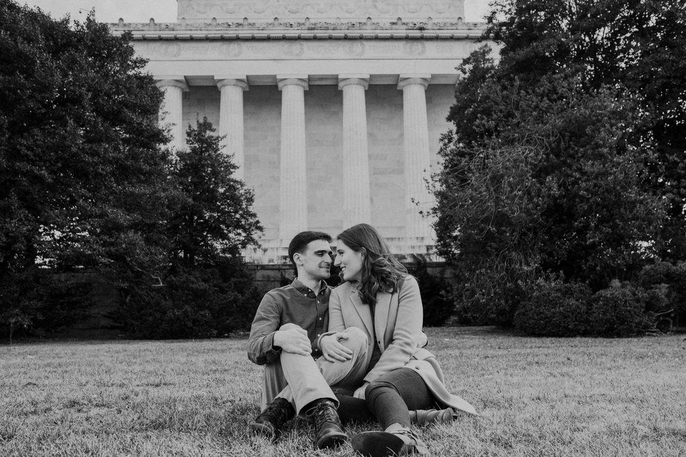 romantic engagement couple in front of the lincoln memorial
