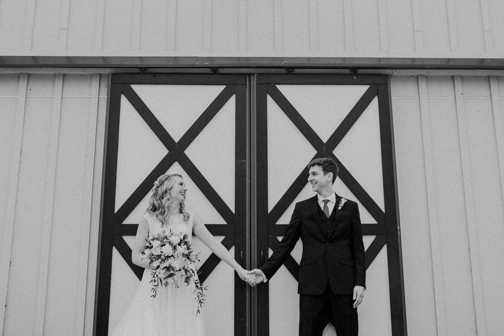 shadow creek barn doors wedding couple