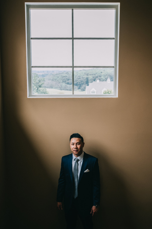 blue valley winery wedding groom portrait