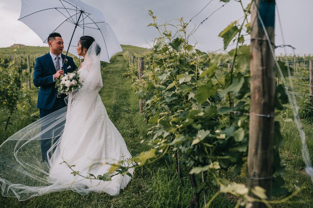 blue valley vineyard wedding portraits in the rain