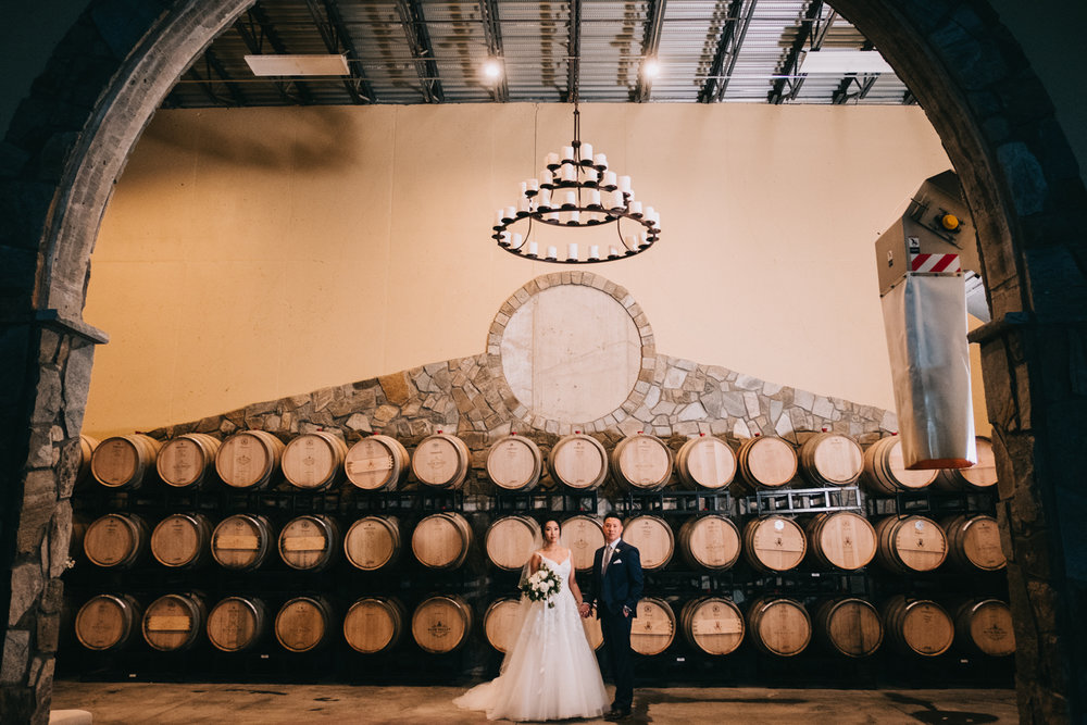 blue valley winery and vineyard wine barrel wedding portraits