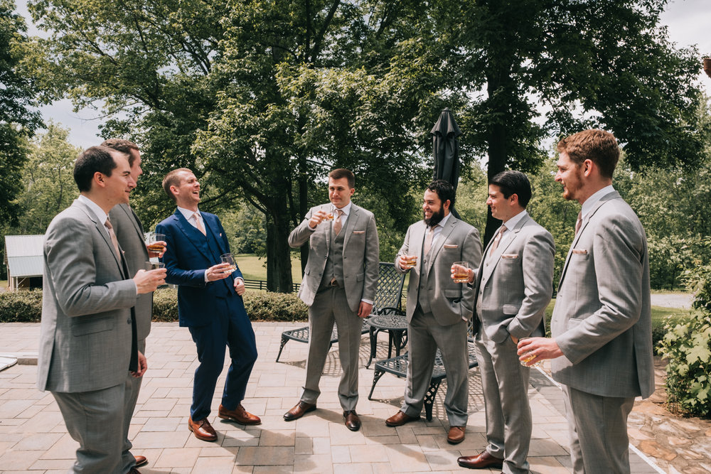 groomsmen getting ready bourbon and laughs