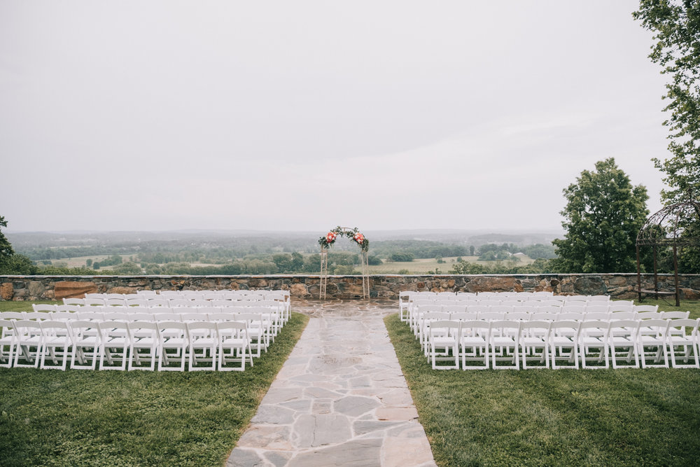 the stables at bluemont vineyard wedding setup on a rainy day