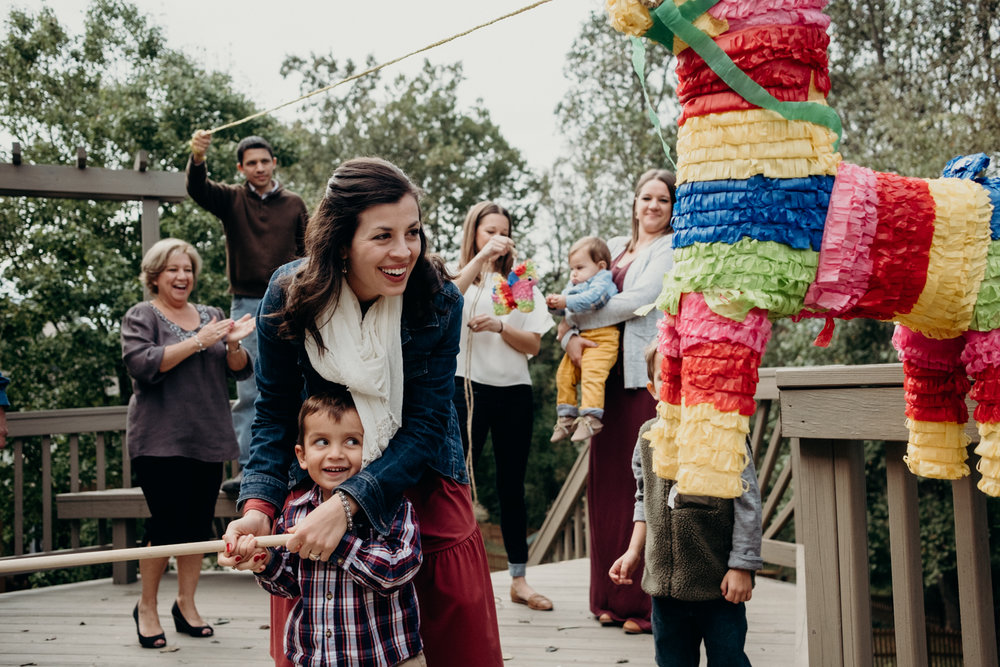 family photography lifestyle hitting pinata games