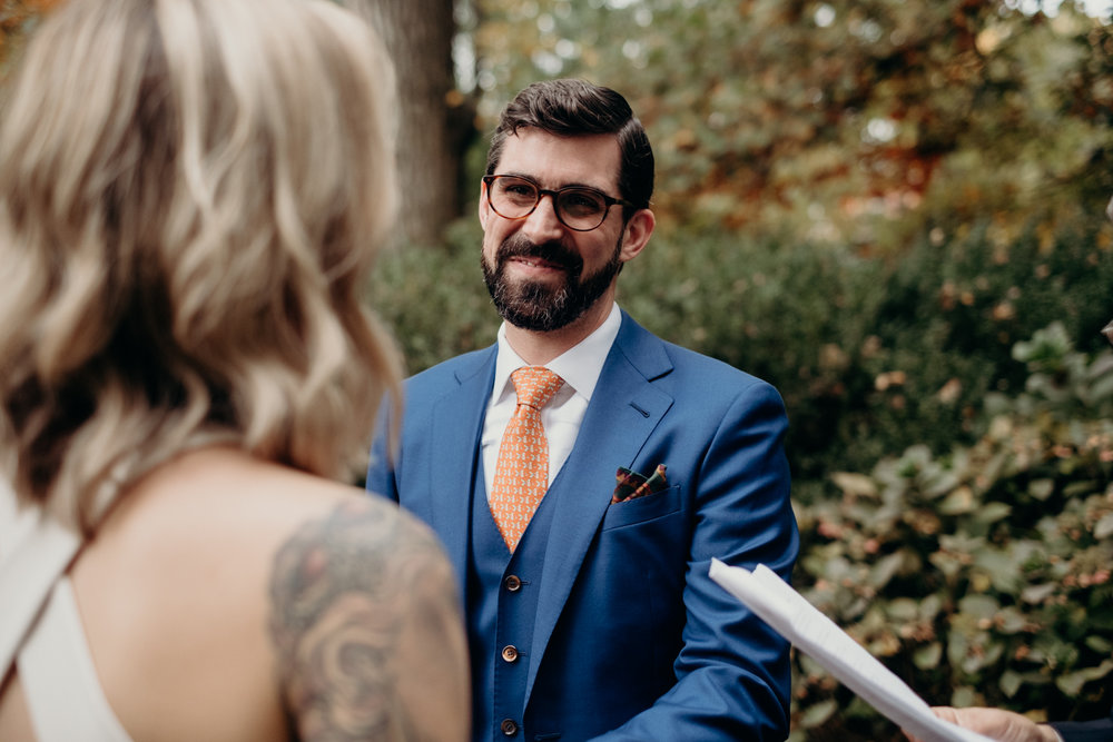 groom listens to wedding vows