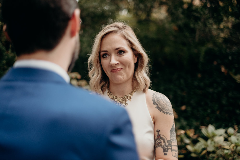 bride listens to wedding vows