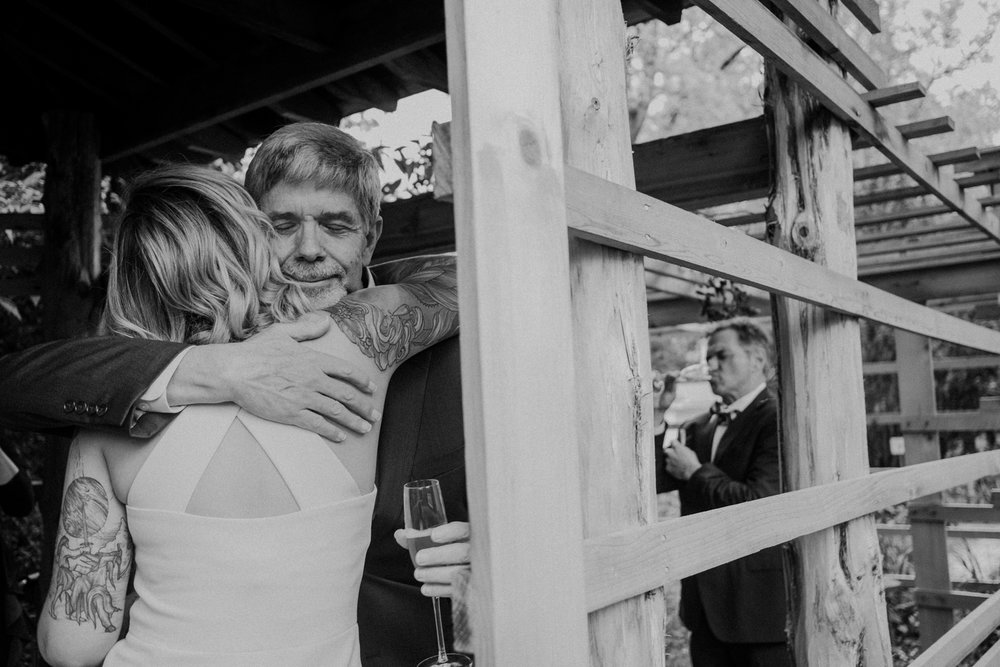 bride hugs her father during toasts dc wedding