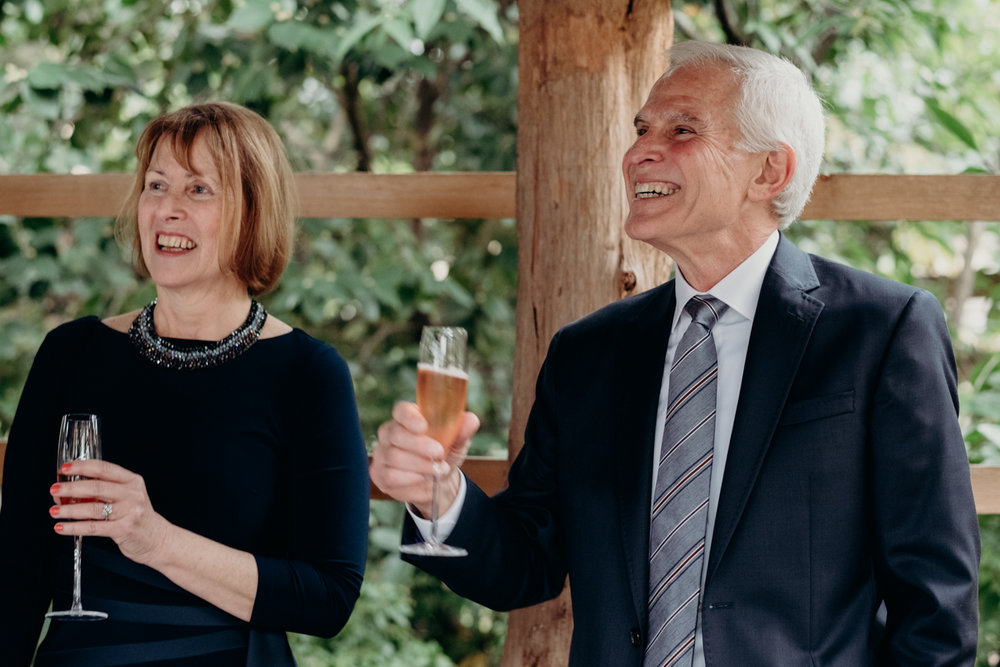 groom's parents toast the couple
