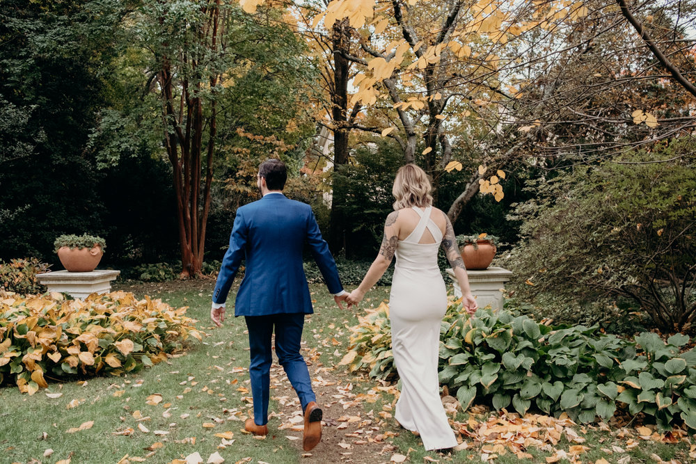 wedding couple walking through tudor place gardens