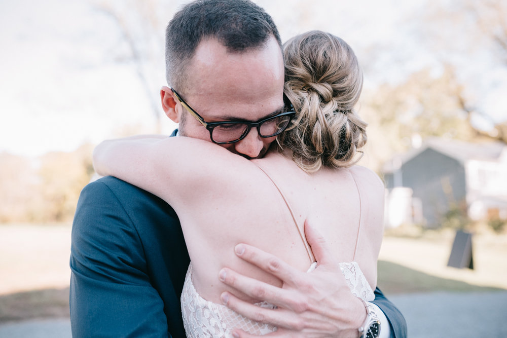 Groom embraces his bride after seeing her during first look at 48 Fields