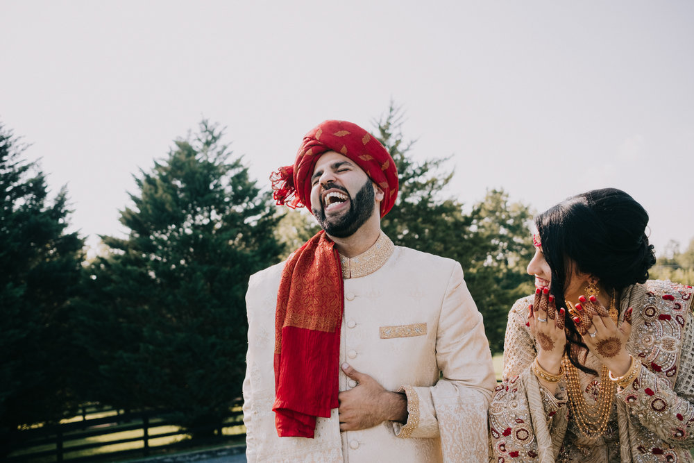 bride and groom see each other during first look and laugh with joy