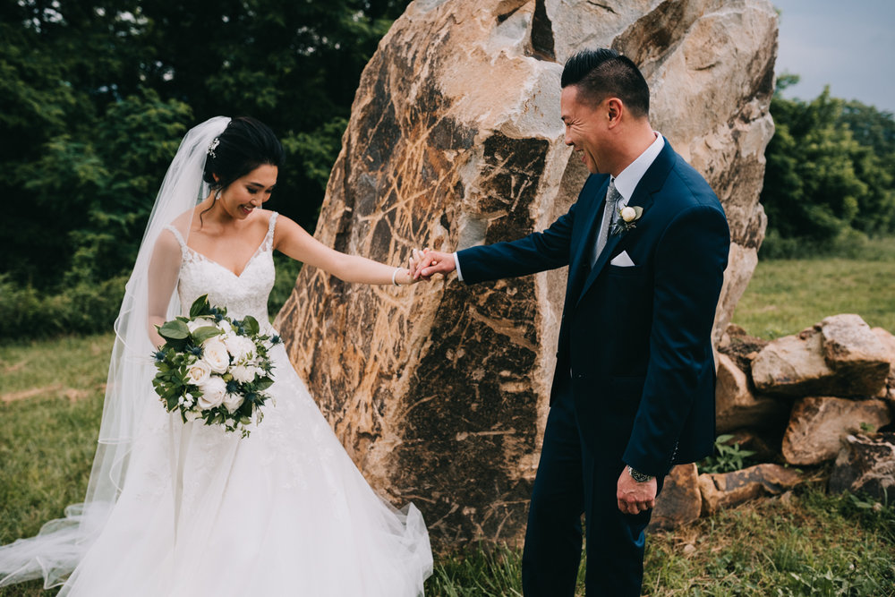 Groom sees bride for the first time with huge smile during first look