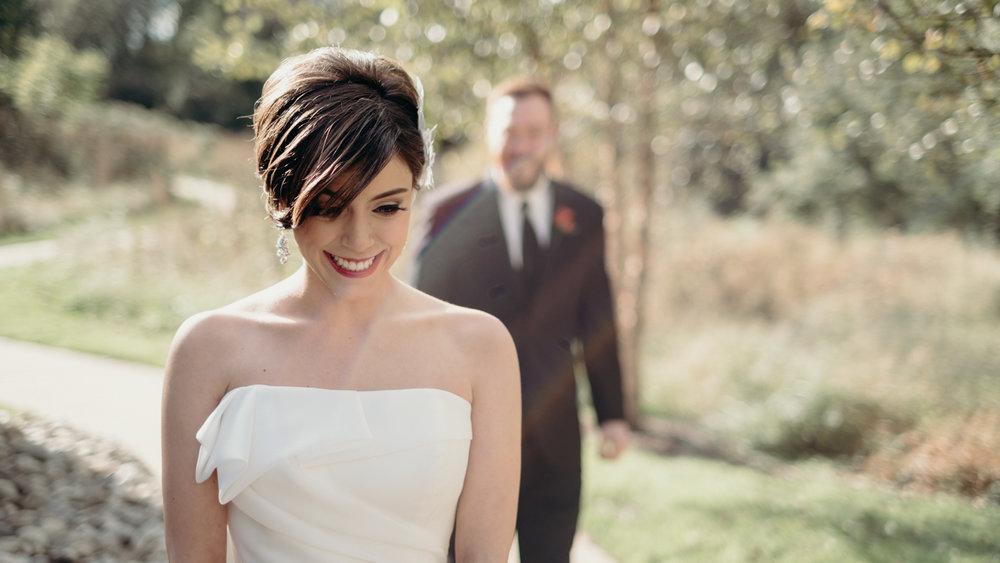 groom walks up to surprise bride during first look at Salamander Resort