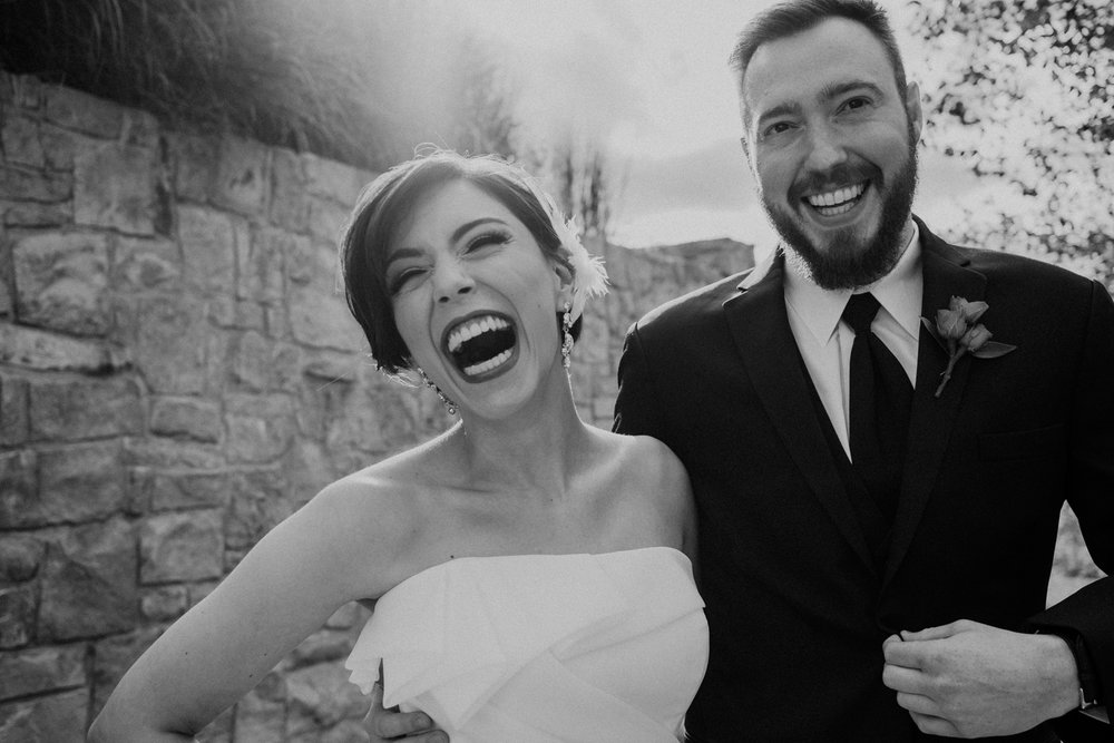 bride and groom laugh during their first look at classy Virginia wedding