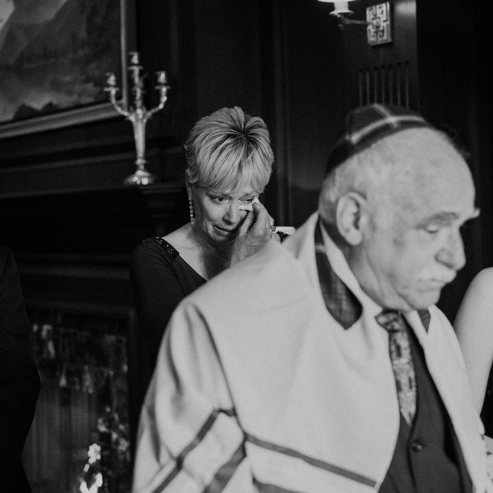 Mother wipes tears as rabbi leads the Ketubah ceremony at Middleburg wedding