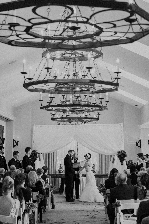Indoor salamander resort wedding ceremony under chandeliers