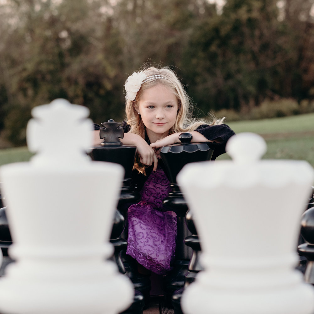 flower girl playing life size chess at middleburg wedding