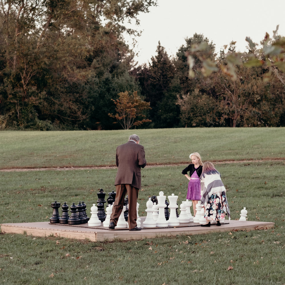 guests play giant game of chess at salamander resort during wedding