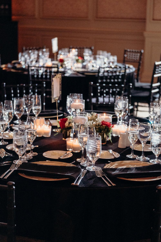 salamander resort wedding reception table setting black and gold
