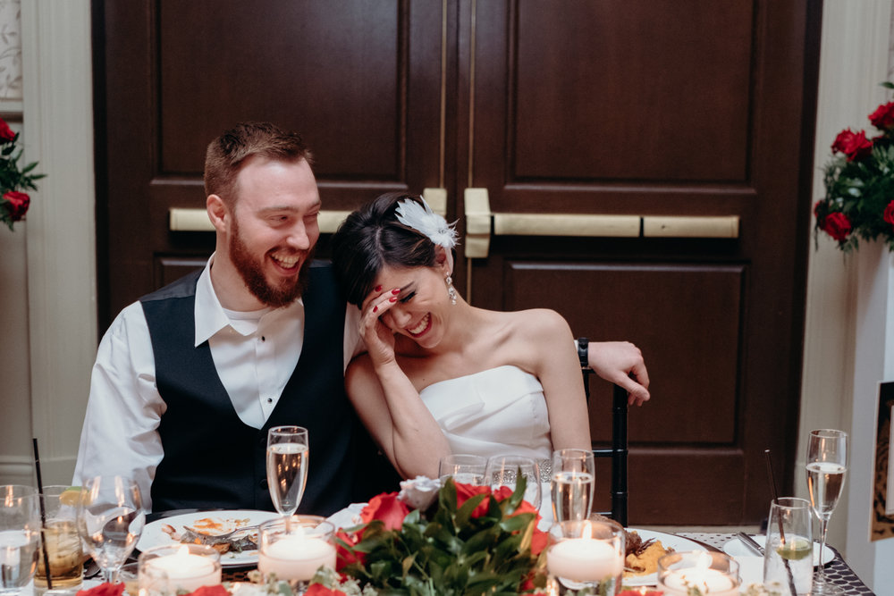 bride and groom laughing during toasts at middleburg wedding