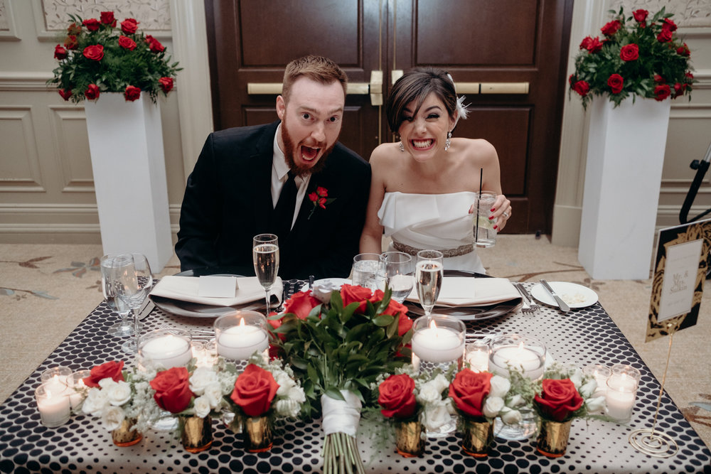 bride and groom at their table excited to eat