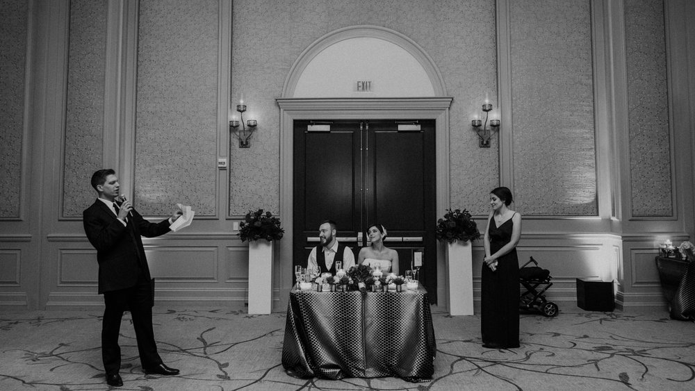 best man cheers during toasts at middleburg wedding