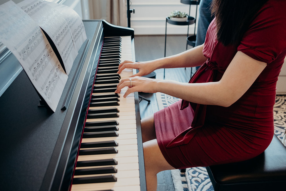 A pregnant mother plays the piano for her unborn baby.