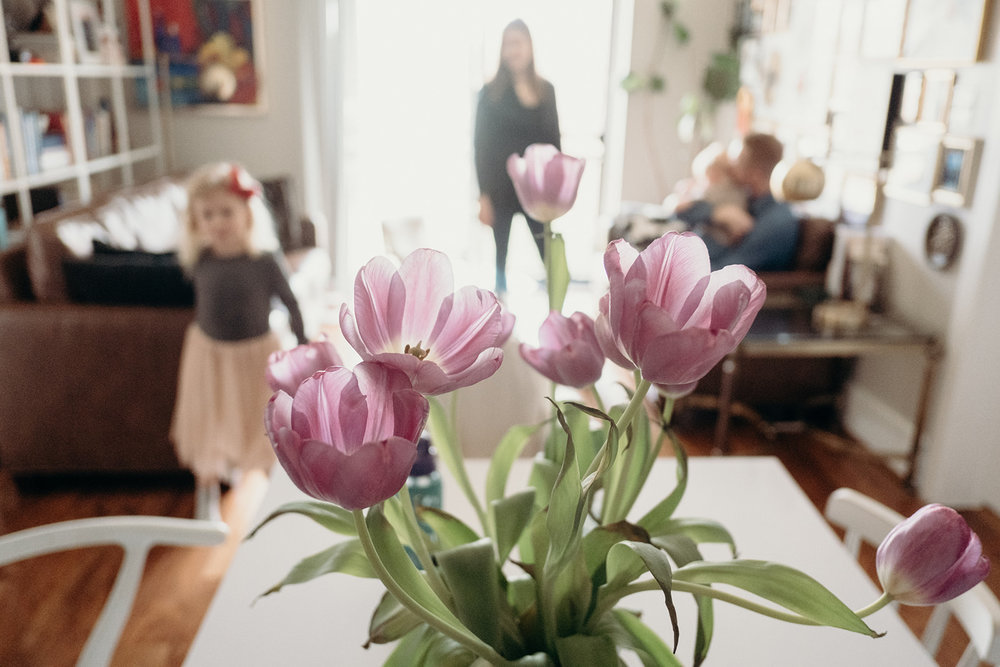 A bouquet of tulips adorns the kitchen table of a family in a little apartment in Washington, DC.