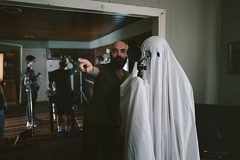 "David Lowery and Casey Affleck on the set of ""A Ghost Story."""