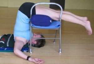 Plow pose on a chair