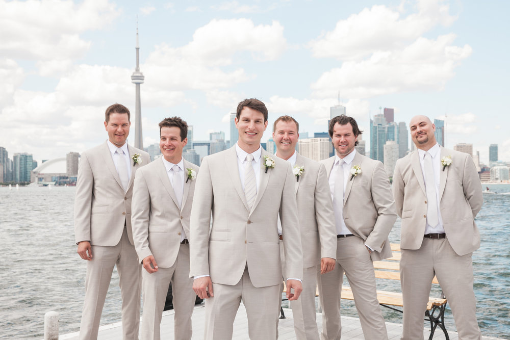Groom and groomsmen with Toronto skyline in background