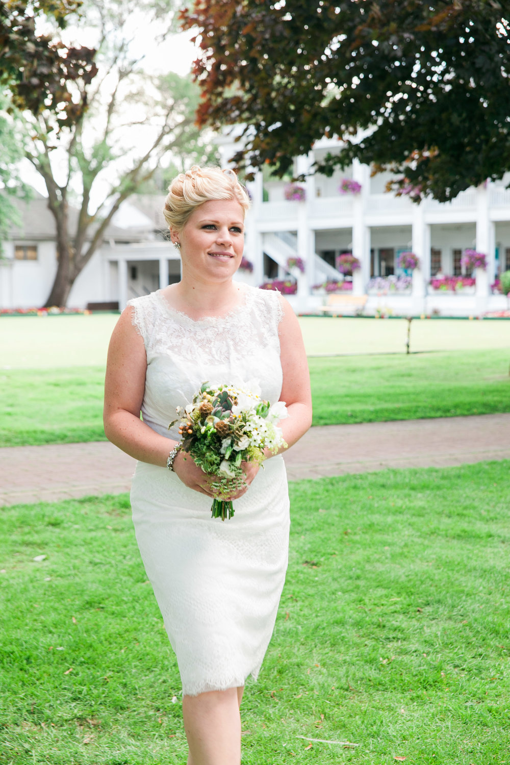 Bridesmaid walking down aisle at Yacht Club wedding