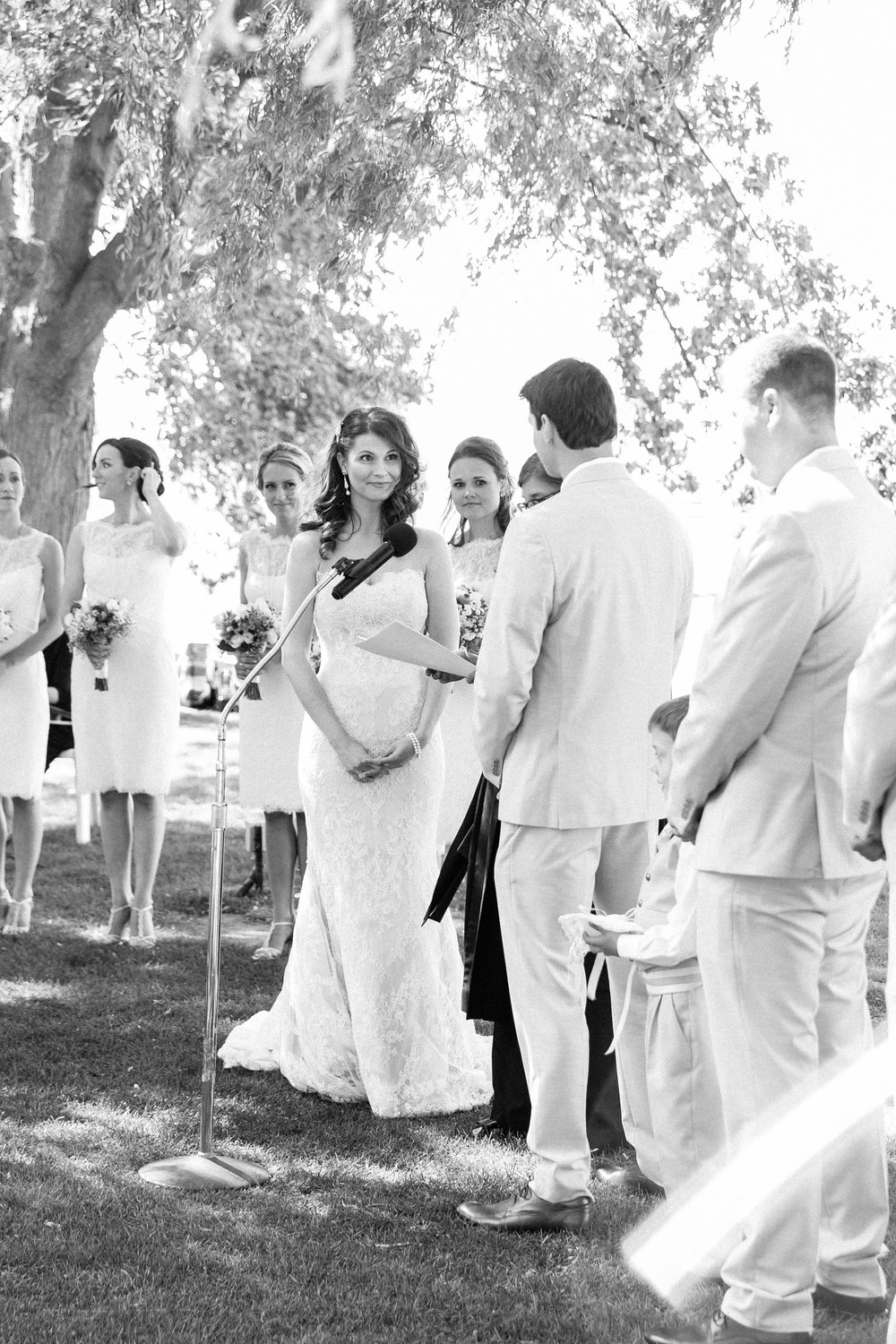Groom saying vows to bride at outdoor summer wedding in Toronto