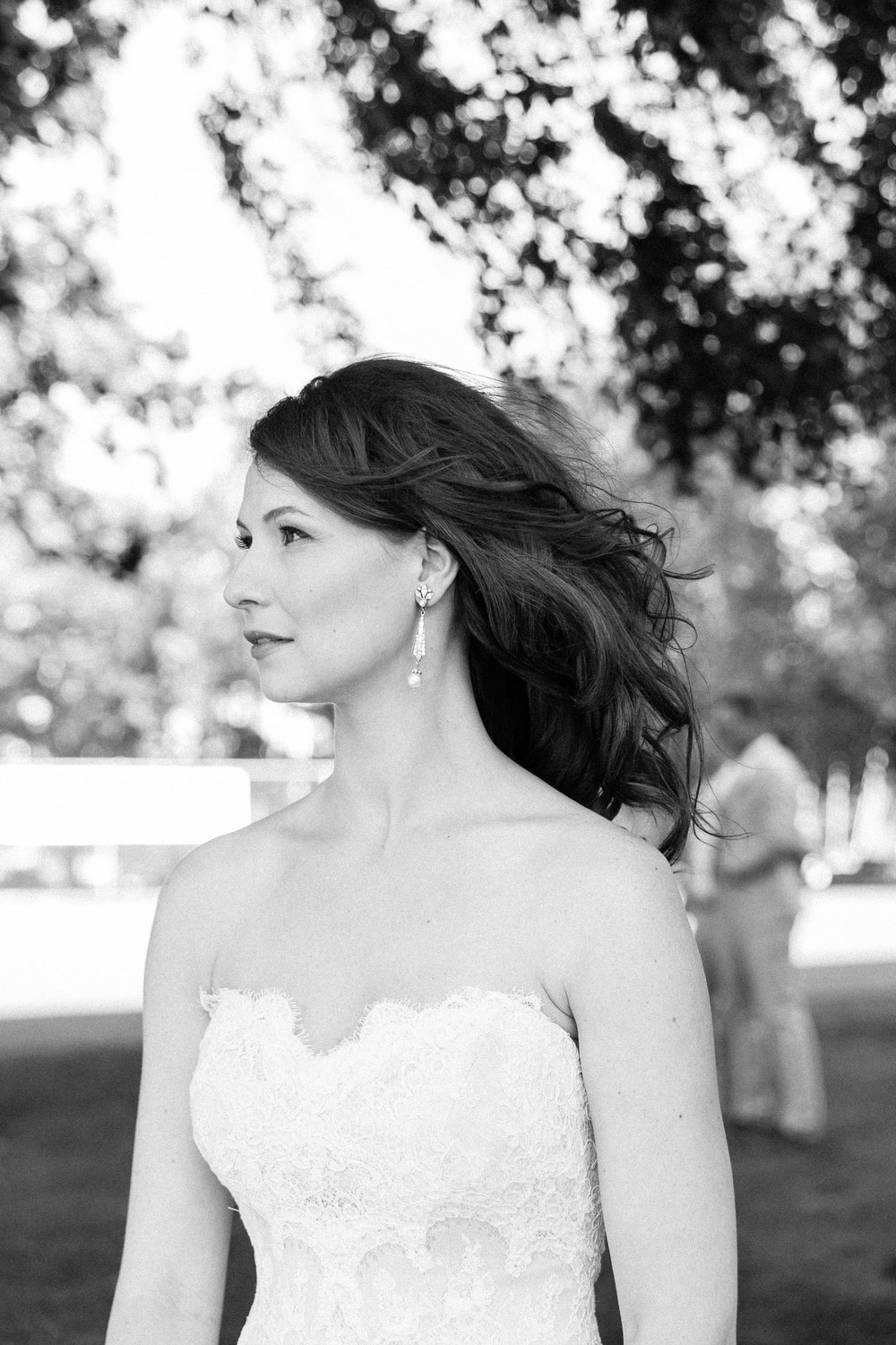 Black and white photos of a bride outside