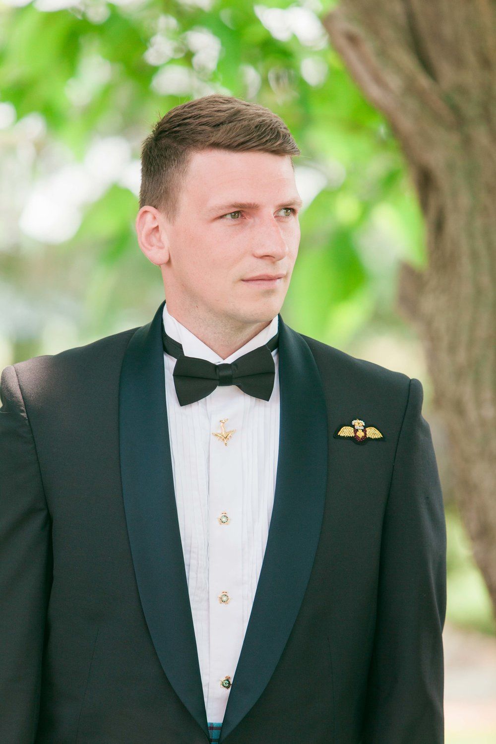 Groom in navy suit and bowtie