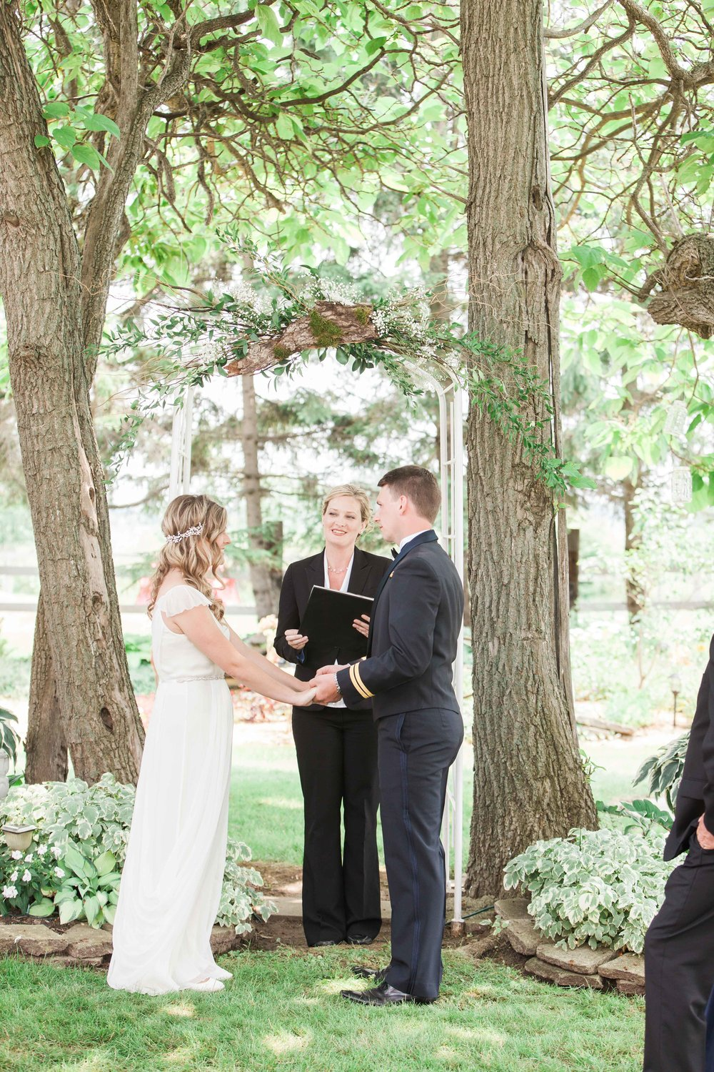 Bride and groom exchanging vows at outdoor wedding