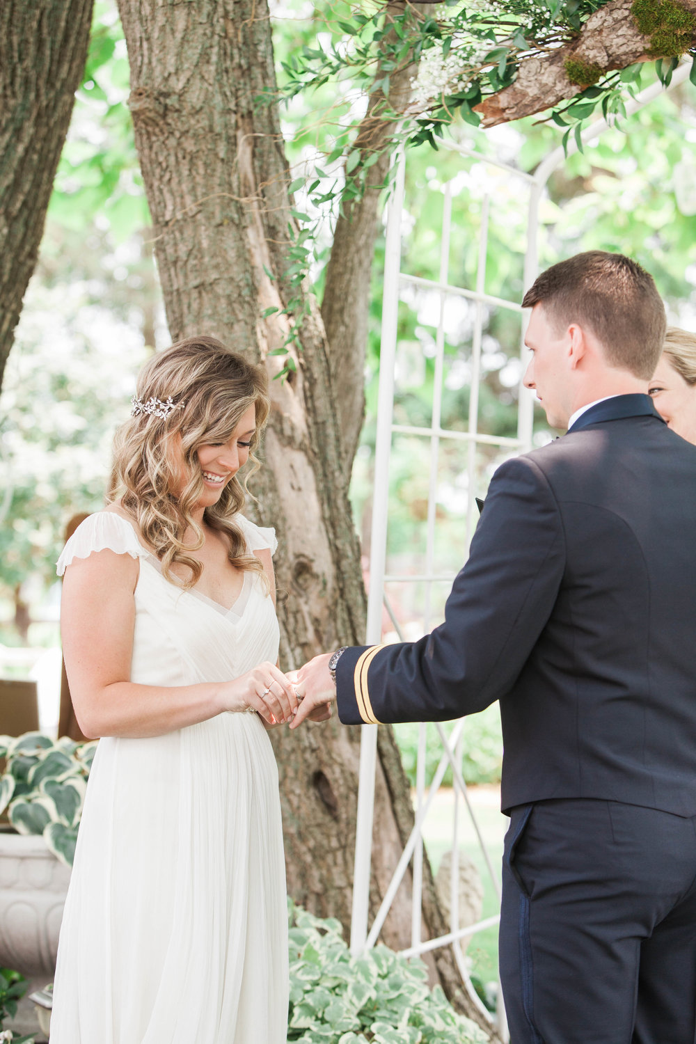 Bride and groom exchanging rings at intimate wedding