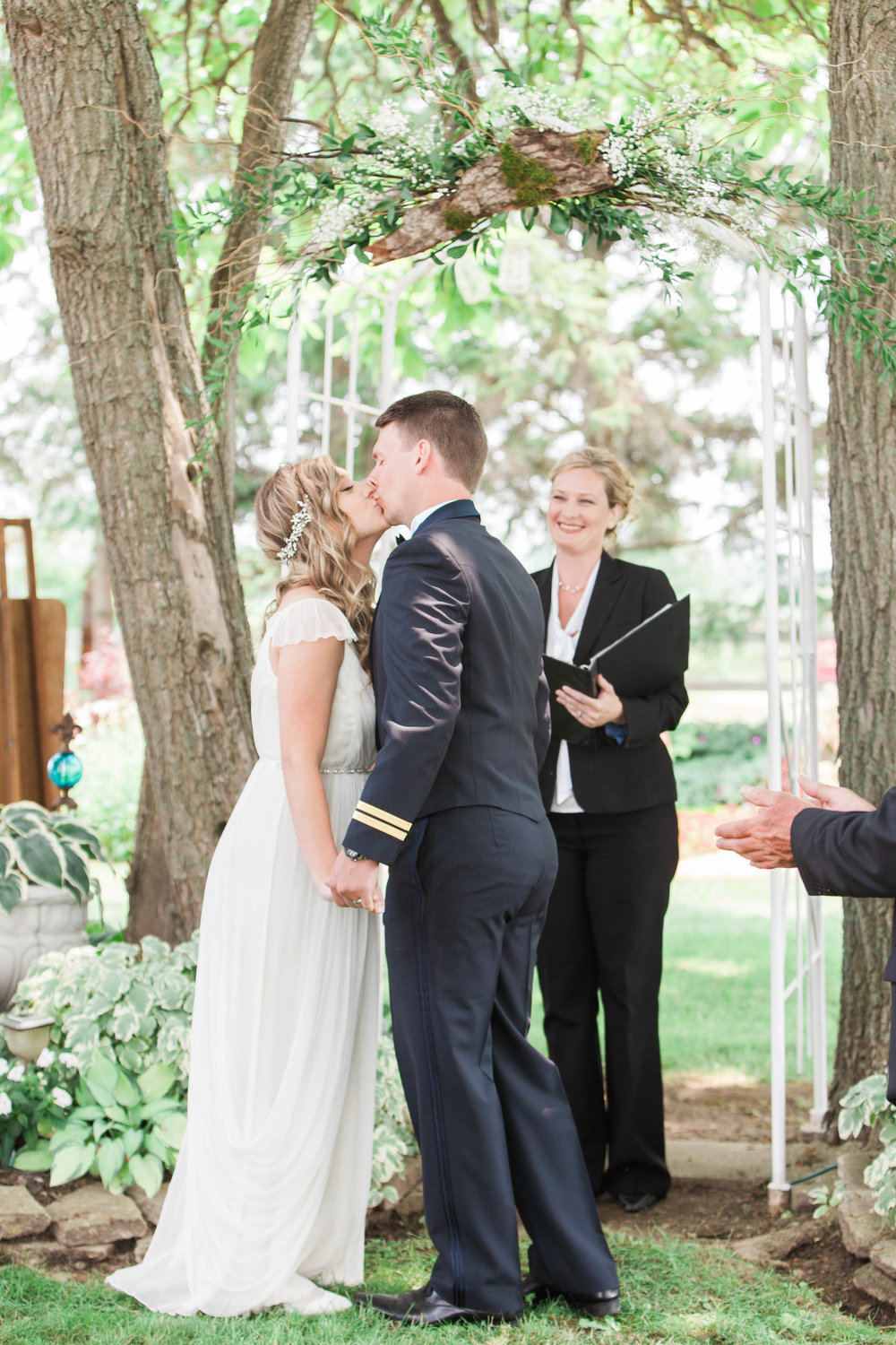 First kiss at intimate outdoor wedding