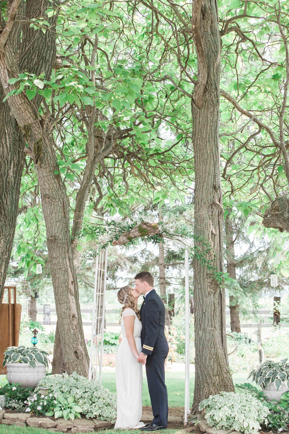 Bride and groom photos at intimate summer wedding