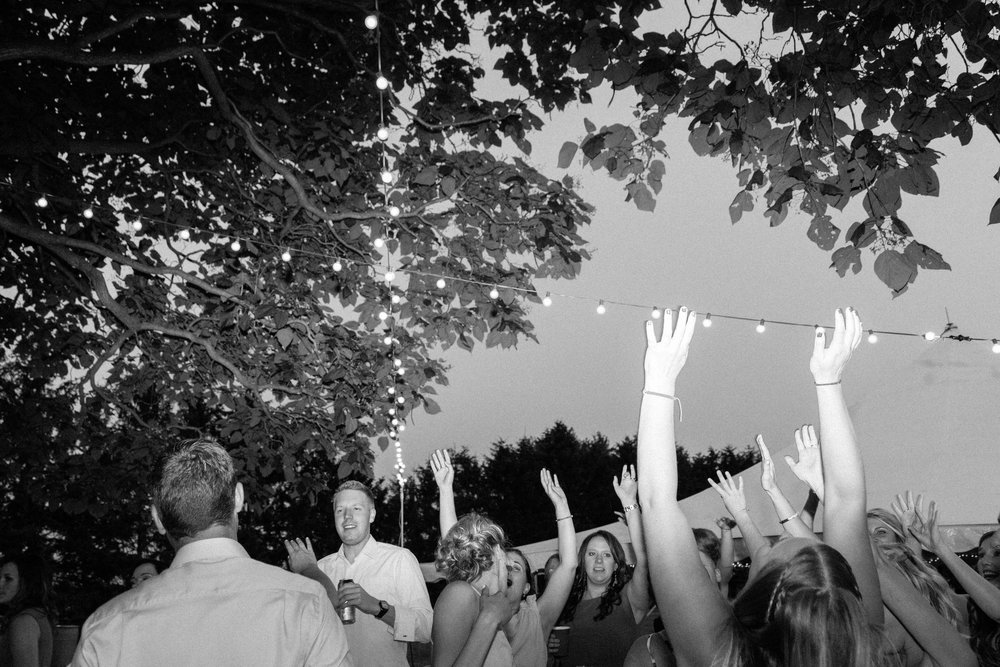 Wedding guests dancing at outdoor wedding