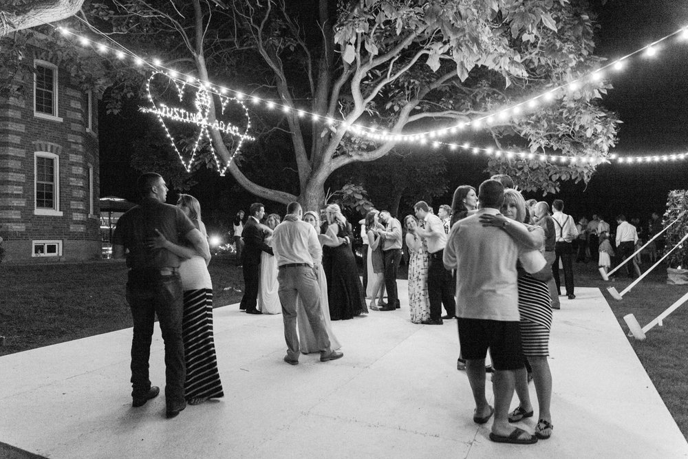 Guest dancing under the stars at Ontario farm wedding